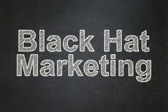 Business concept: Black Hat Marketing on chalkboard background. Business concept: text Black Hat Marketing on Black chalkboard background Stock Photography
