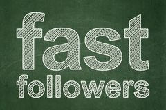 Business concept: Fast Followers on chalkboard background. Business concept: text Fast Followers on Green chalkboard background Royalty Free Stock Images