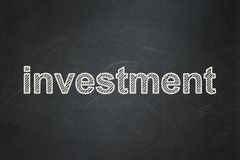 Business concept: Investment on chalkboard background. Business concept: text Investment on Black chalkboard background Royalty Free Stock Photo