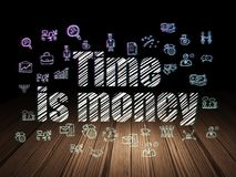 Business concept: Time Is money in grunge dark room. Business concept: Glowing text Time Is money,  Hand Drawn Business Icons in grunge dark room with Wooden Stock Photography