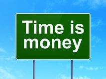 Business concept: Time is Money on road sign background Royalty Free Stock Image