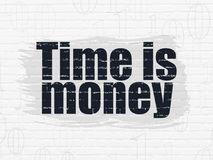 Business concept: Time is Money on wall background. Business concept: Painted black text Time is Money on White Brick wall background with  Binary Code Royalty Free Stock Photo