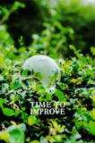Business Concept : TIME TO IMPROVE word on green background Royalty Free Stock Photography