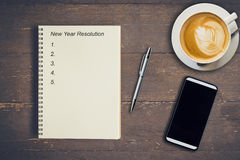 Business concept - Top view notebook writing New Year Resolution Stock Photos