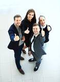 Business concept - Top view of successful young business people. Showing thumbs up Stock Photo