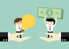 Business concept. Two businessmen standing on big hands exchanging money for idea. Stock Photo