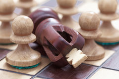 Business concept of win or defeat, loss Chessboard and figures of the king and pawns. Royalty Free Stock Image