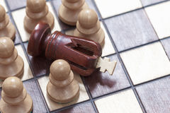 Business concept of win or defeat, loss Chessboard and figures of the king and pawns. Royalty Free Stock Photos