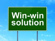 Business concept: Win-win Solution on road sign background. Business concept: Win-win Solution on green road highway sign, clear blue sky background, 3D Royalty Free Stock Image