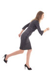 Business concept - woman in dress running isolated on white Stock Photography
