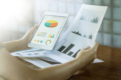 Business concept. Woman`s hands using tablet with financial docu. Business, office concept. Woman`s hands using tablet with financial document Stock Photography