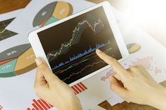 Business concept. Woman`s hands using tablet with financial docu. Business, office concept. Woman`s hands using tablet with financial graph screen Stock Images
