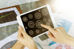 Business concept. Woman`s hands using tablet with financial docu. Business, office concept. Woman`s hands using tablet with business icons on screen Stock Image