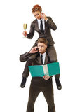 Business concept - work of manager and executor. Celebrating businesswoman riding on busy guy Stock Photo