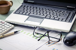 Business concept,working,analyzing, glasses on graph background Stock Images