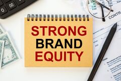 Business concept - notebook writing STRONG BRAND EQUITY