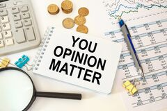 Business concept - notebook writing YOU OPINION MATTER