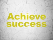 Business concept: Achieve Success on wall background. Business concept: Yellow Achieve Success on textured concrete wall background Stock Image