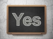 Business concept: Yes on chalkboard background. Business concept: text Yes on Black chalkboard on grunge wall background, 3D rendering Royalty Free Stock Photo