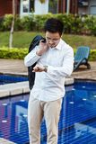 Business Concept - Young Business man checking time for meeting. Royalty Free Stock Images