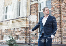 Business concept. Young man rolling his bicycle Stock Images