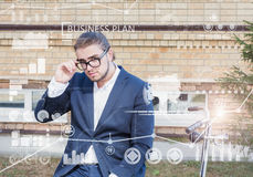 Business concept. Young man rolling his bicycle Royalty Free Stock Photos