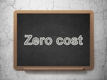 Business concept: Zero cost on chalkboard background. Business concept: text Zero cost on Black chalkboard on grunge wall background, 3D rendering Stock Photo