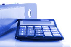 Business concepts clip folders and calculator Stock Images