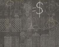 Business concepts doodles on dark brown wooden wall Stock Image