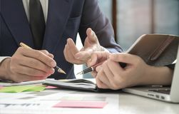 Business concepts,Management is executing the secretary is taking notes. Document placed on the desk stock photos