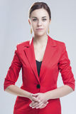 Business Concepts. Natural Portrait of Positive Caucasian Brunette in Red Suit Royalty Free Stock Photography