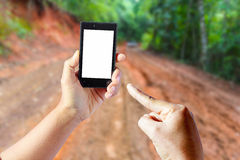 Business conceptual- Focused on left hand holding empty mobile Stock Photo
