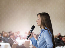 Business conference. Beautiful business woman is speaking on conference Royalty Free Stock Photos