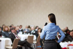 Business conference. Beautiful business woman is speaking on conference royalty free stock images