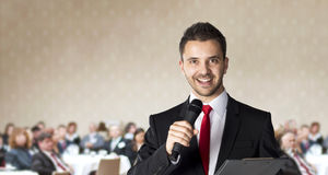 Business conference. Man is speaking on indoor business conference for managers stock photography