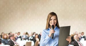 Business conference. Beautiful business woman is speaking on conference Stock Photos