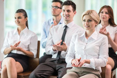 Business conference. Happy business group of people clapping hands during a meeting conference stock photography