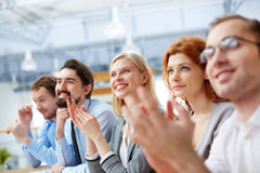 Business conference. Image of a business team with its leader being at the conference on the foreground royalty free stock image