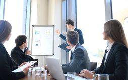Business conference presentation with team training flipchart office. Business conference presentation with team training flipchart office stock photo