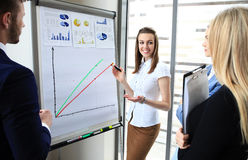 Business conference. Presentation with team training flipchart office stock image