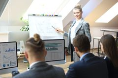 Business conference presentation with team training flipchart office.  royalty free stock image