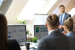 Business conference presentation with team training flipchart office.  stock images