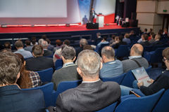 Business conference. Rear view of people on the business conference stock image