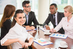 Business conference. Successful business people sitting at conference room and working on business strategy stock photos