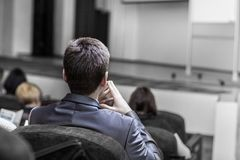 Students of business courses sitting in the conference room for a business training. Business conferences and business training. conference room stock image