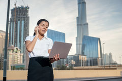 Business. Confident businesswoman standing on a street in formal Stock Photography