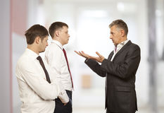 Business conflict concept. Three businessman are trying to come to an agreement Stock Photography