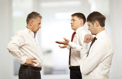 Business conflict concept. Three businessman are trying to come to an agreement Royalty Free Stock Photos