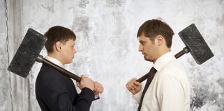 Business conflict concept. Two businessman are trying to come to an agreement Stock Image