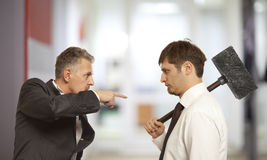Business conflict concept. Two businessman are trying to come to an agreement Stock Images